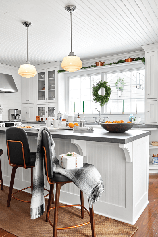 The large kitchen island gives extra counter space, and glass doors lighten the mood and add an airy touch.