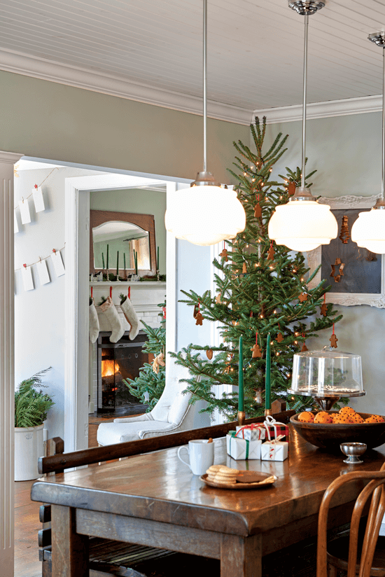 The informal dining room provides a space where friends and family can gather on the family heirloom bench and enjoy the gingerbread-decorated Christmas tree in the corner.