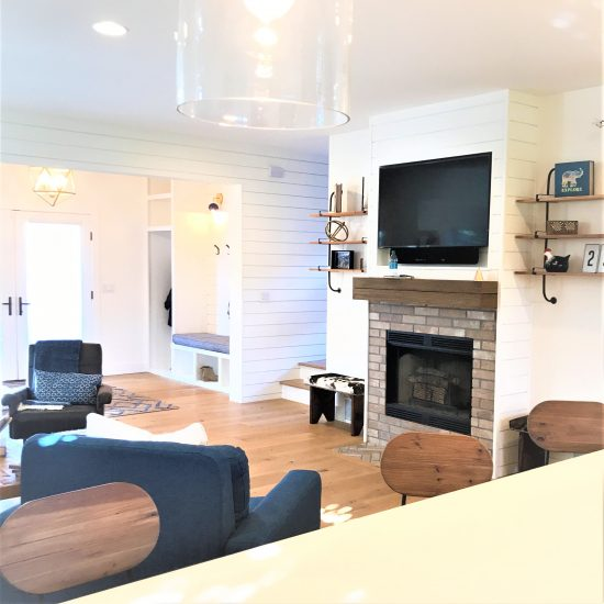 The fireplace was updated with brick tile and wrapped with Windsor One Shiplap to complete the modern farmhouse look.