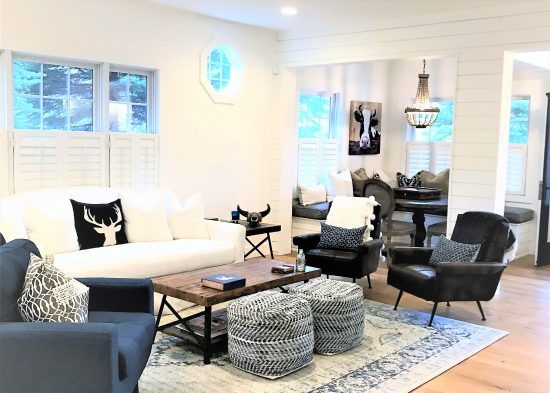 Open-concept living and dining area featuring a blue and white color palette.