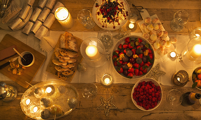 candlit christmas dessert table