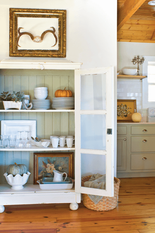 In an older kitchen that doesn't offer a lot of storage, a cabinet like this can serve as additional storage for dishes as well as serve as a conversation piece.