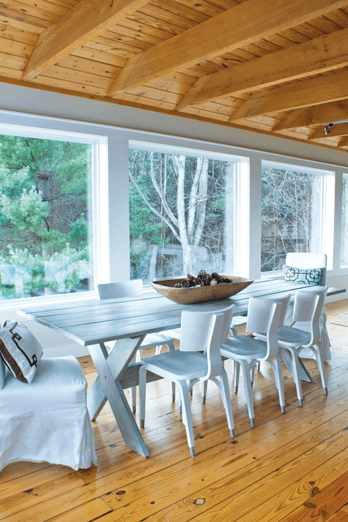 Formerly a picnic table, Angela cleaned and repainted it to capture the cozy vibe in the dining room which is underscored by the gorgeous views beyond the floor-to-ceiling windows.