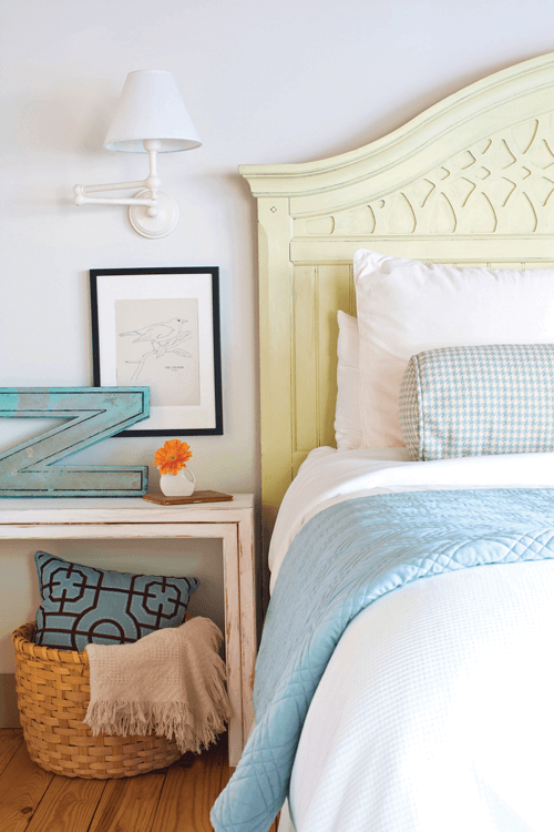 white and blue color pairings give the master bedroom and fresh and airy look