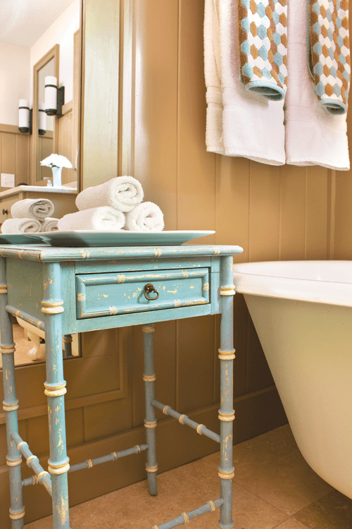 this vintage table was given a fresh coat of paint making it a great addition to the bathroom