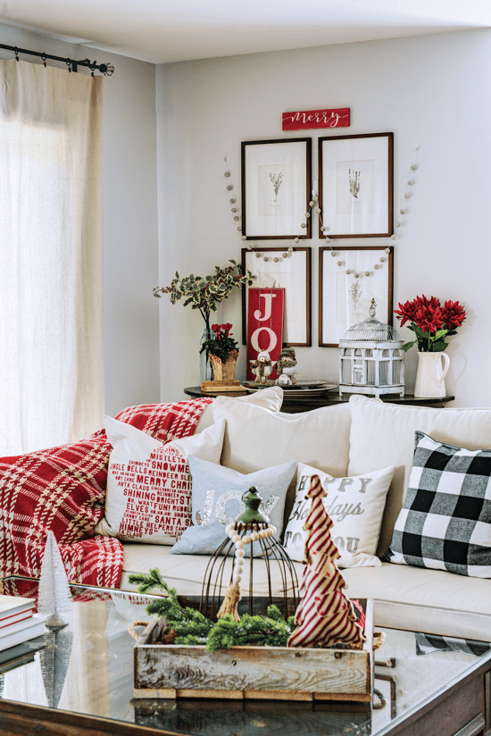 sofa with holiday pillows and decor