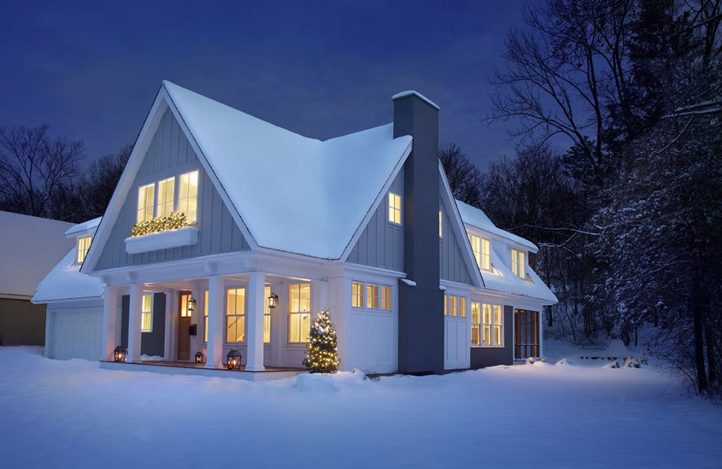 snowy cottage with green building techniques
