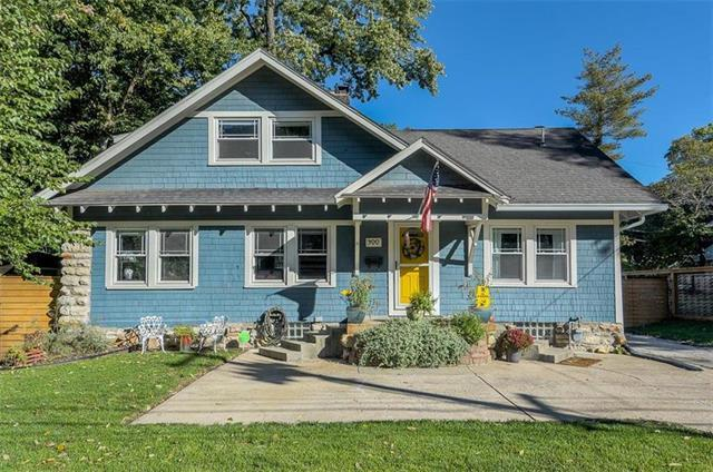 Great blue cottage with a yellow door for sale in Kansas City!