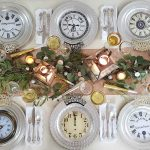 Fun clock plates, glittery details, candlelight and mixed metals at this New Year's Eve table provide guests with a dreamy start to the new year.