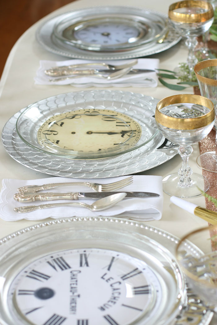 Don't be afraid to mix and match plates, glasses and other tableware for your New Year's Eve table decor. It only adds to the interest of the New Year's Eve tablescape.