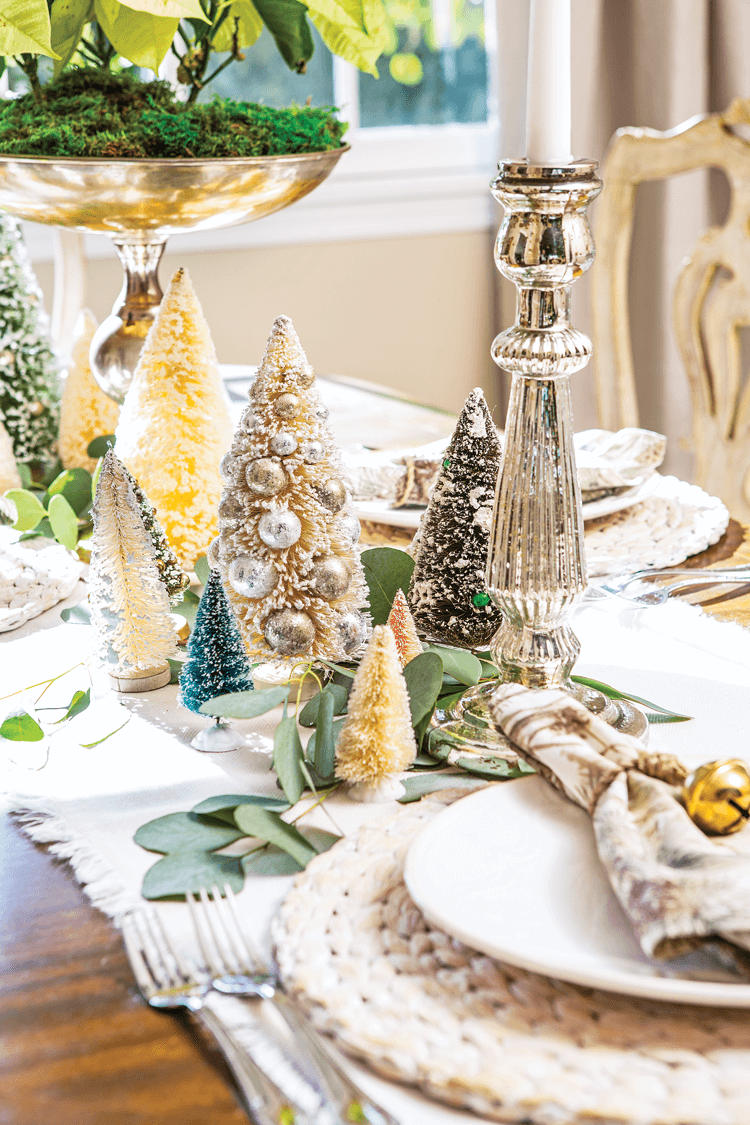 Vintage bottle brush trees and candlesticks add a touch of metallic to Maison de Cinq's neutral and natural christmas decor tablescape