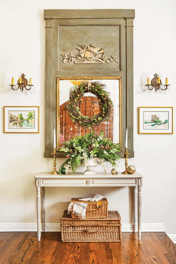 A modern French country entryway decorated with neutral and natural christmas decor