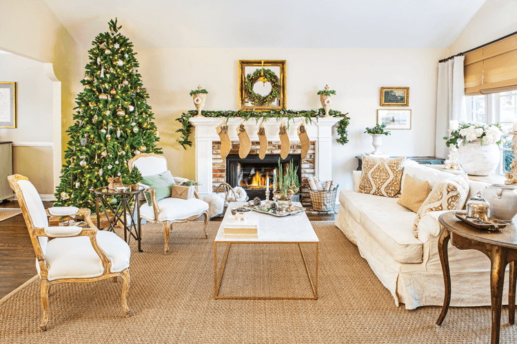 The living room at Maison de Cinq is decorated with neutral and natural Christmas decor