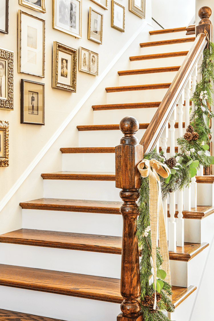 A garland of natural greenery adorns the banister at Maison de Cinq.