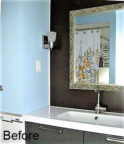 bathroom vanity prior to the renovation, with white countertop and basic hardware.