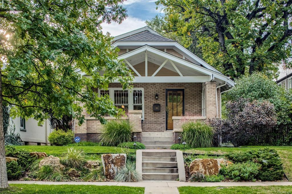 Quaint Denver cottage with an amazing porch and roofline.