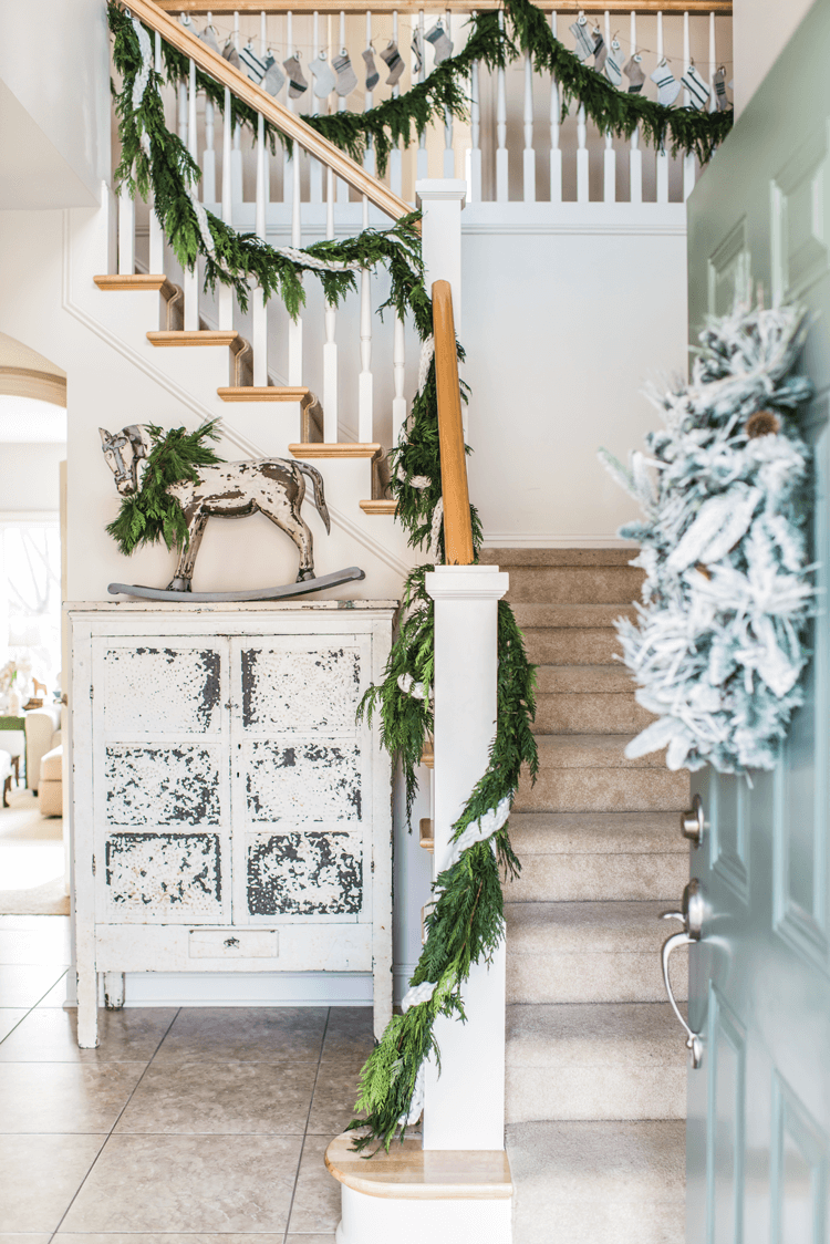 Fresh greenery in the form of natural garlands and real wreaths are an essential part of Miss Mustard Seed's Christmas decor.