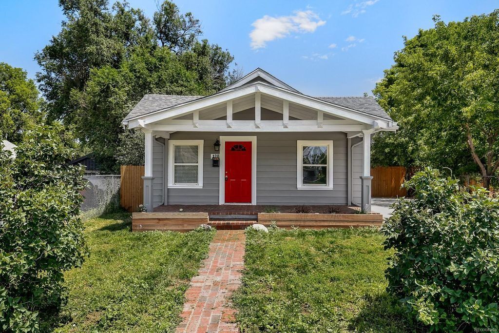 Quaint Denver cottage with an amazing porch. and red door