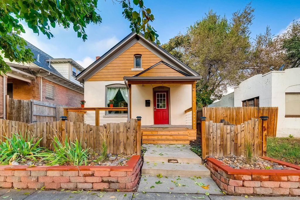 Quaint Denver cottage with an amazing curb appeal.
