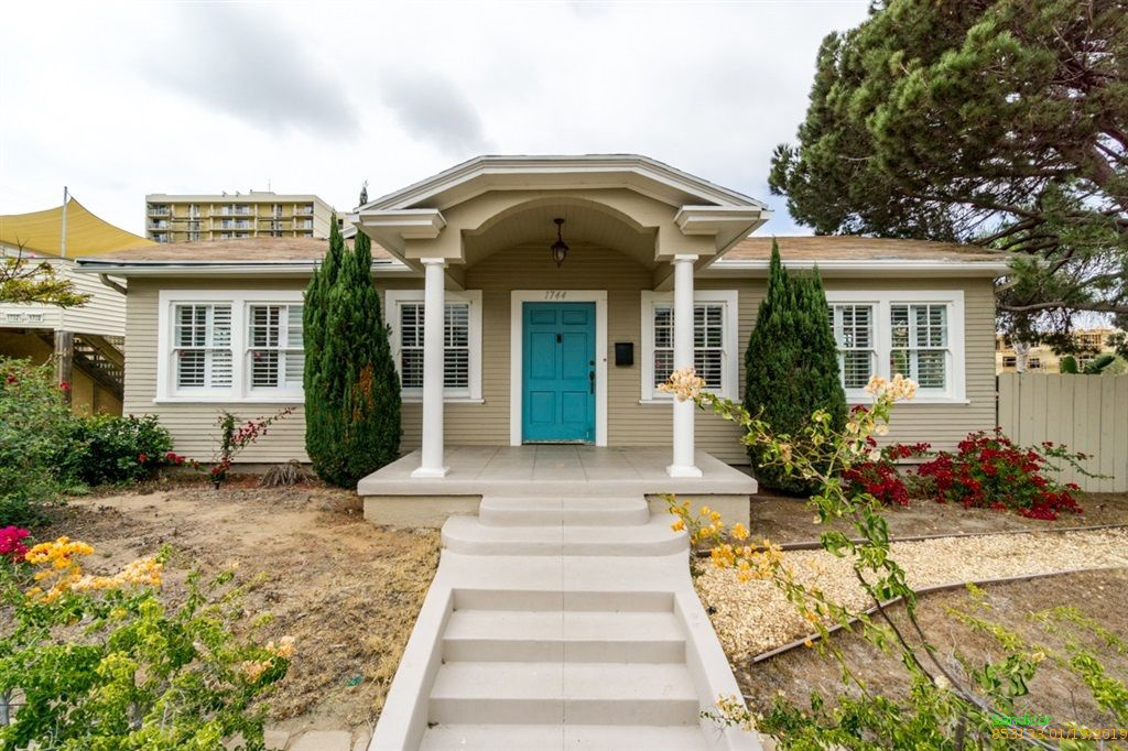 Exterior of a San Diego cottage with bright turquoise door