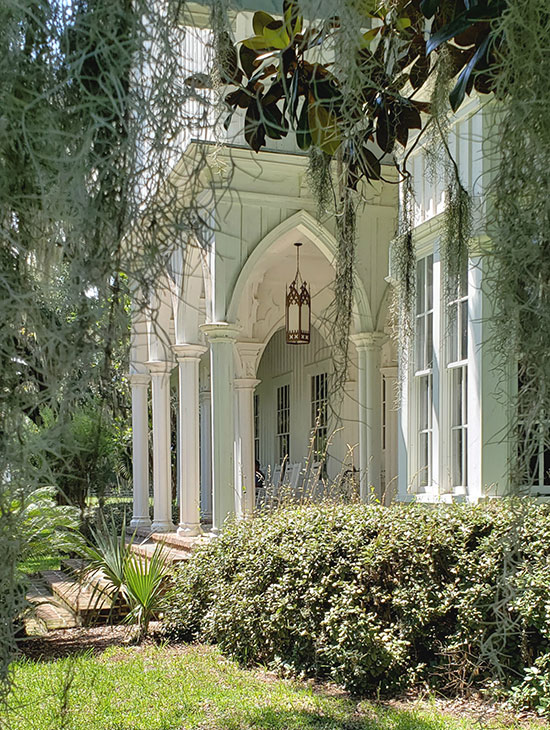 gothic arches and porch framed by spanish moss