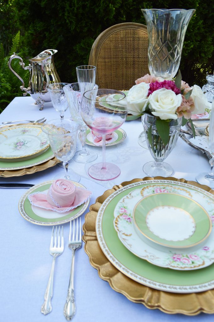 romantic table setting with limoge, crystal and gold chargers