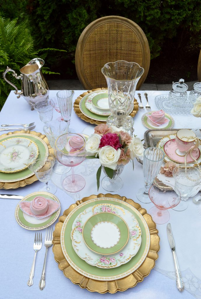 romantic table setting with limoge, crystal and gold.