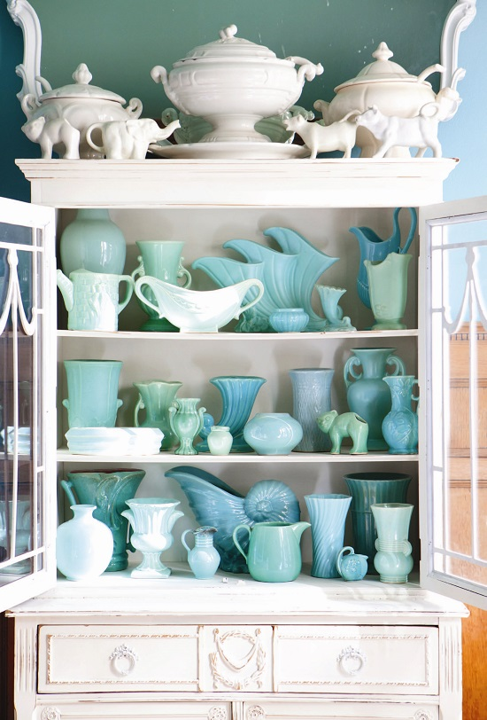 blue vintage pottery in a white china cabinet // collecting by color