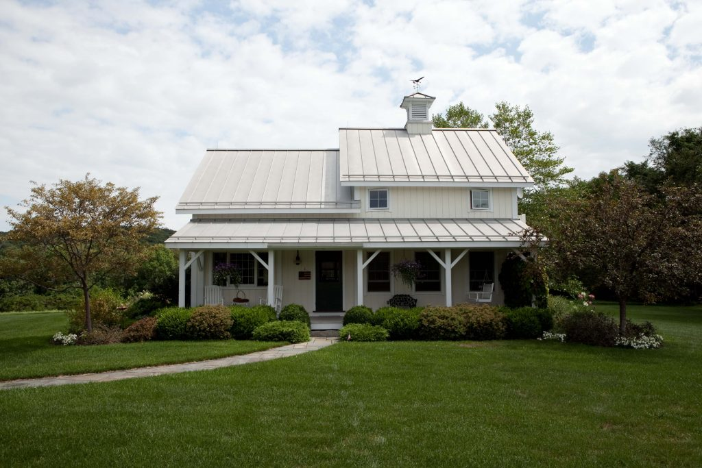 The 2019 Project House will tout a farmhouse roof and porch much like this past project built by Yankee Barn Home.