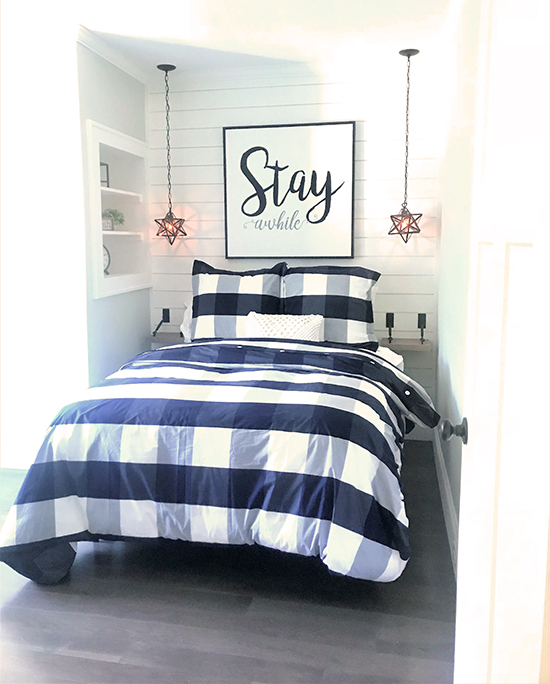tiny guest room with plaid bedding
