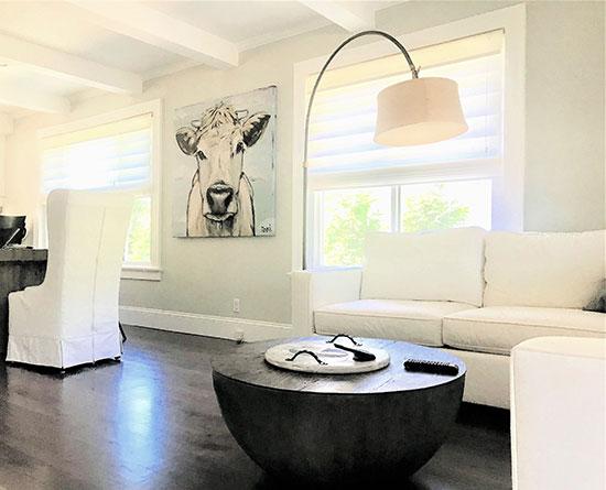 white modern sofas with cow art