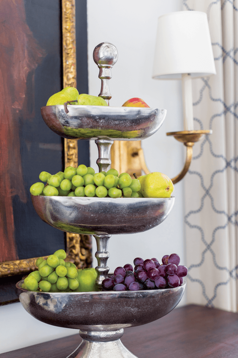 An Italian Baroque-style commode from the 19th-century is filled with fruit.