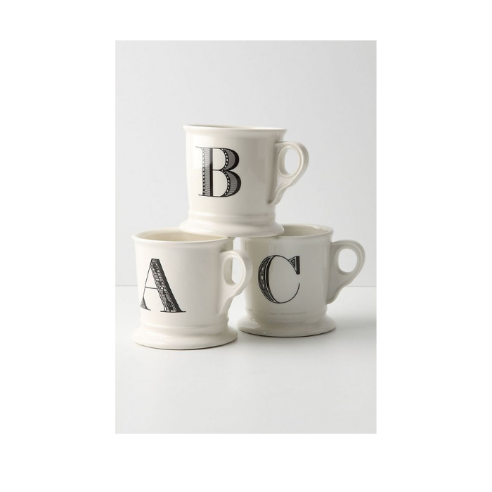 Stack of three white mugs each monogrammed with A, B and C