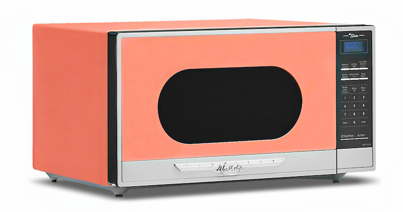 A retro microwave in a bright coral color.
