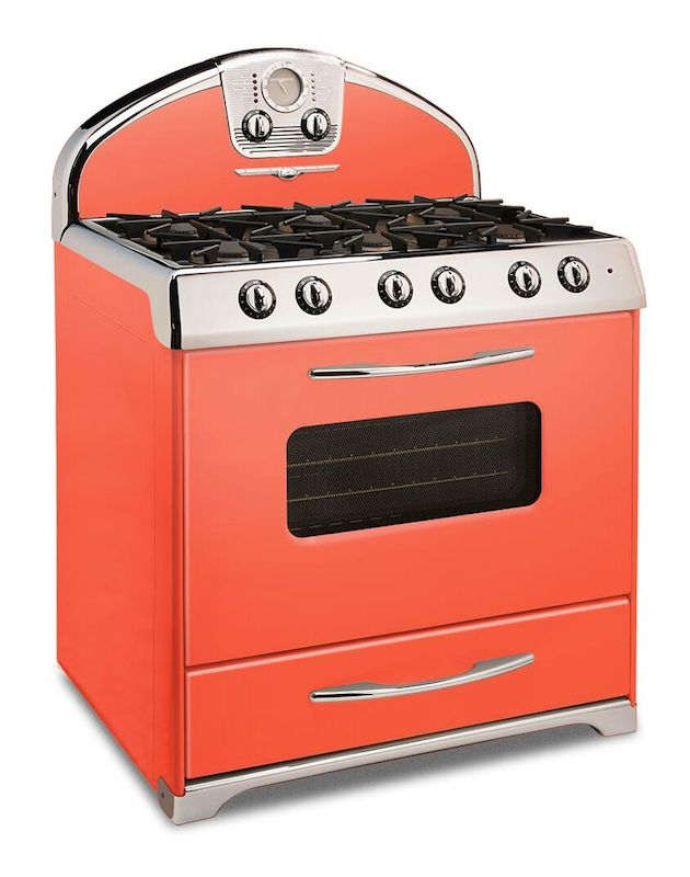 A retro stove range in a bright coral color.