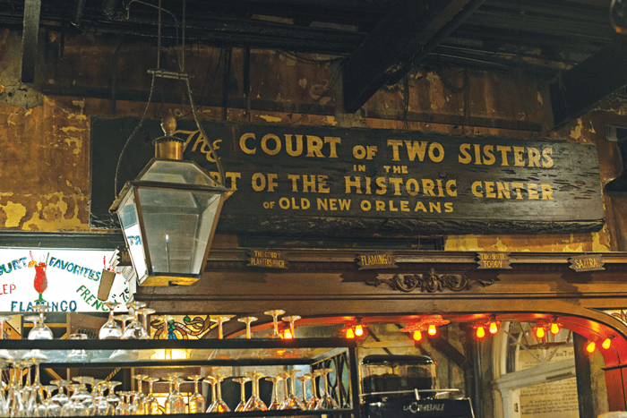 Entryway and storefront of the The Two Court Sisters restaurant.