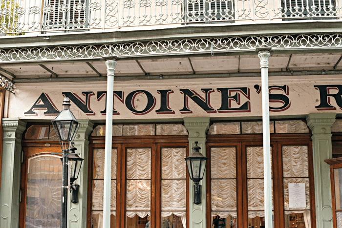 New Orleans street front signage of Antoine's restaurant.
