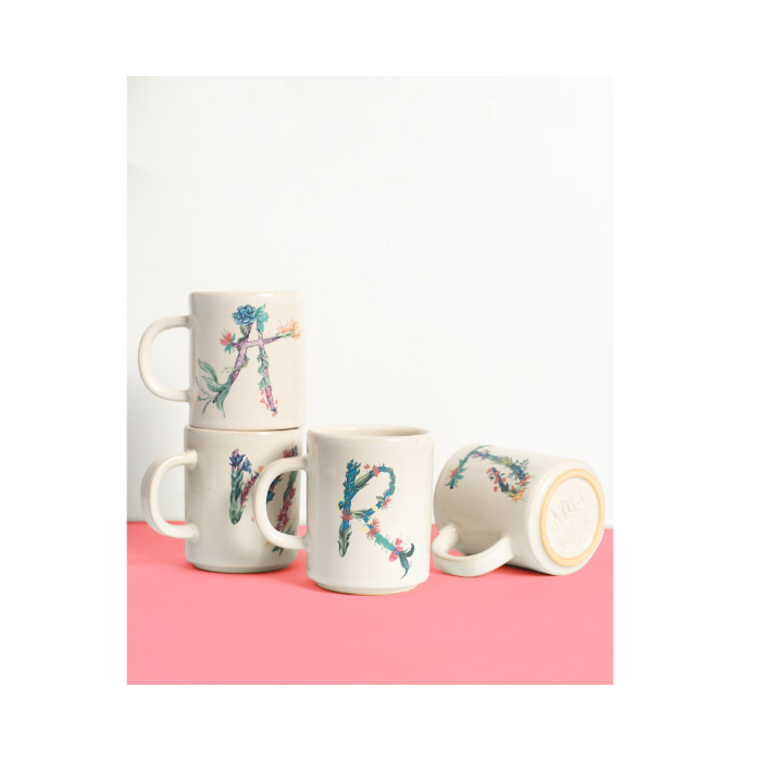 Stack of Monogram Mugs on White and Pink Backdrop
