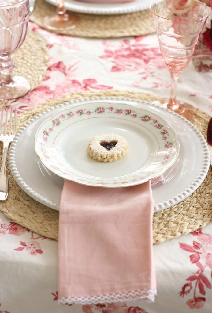 heart jam cookie on a pink and red galentines tablescape