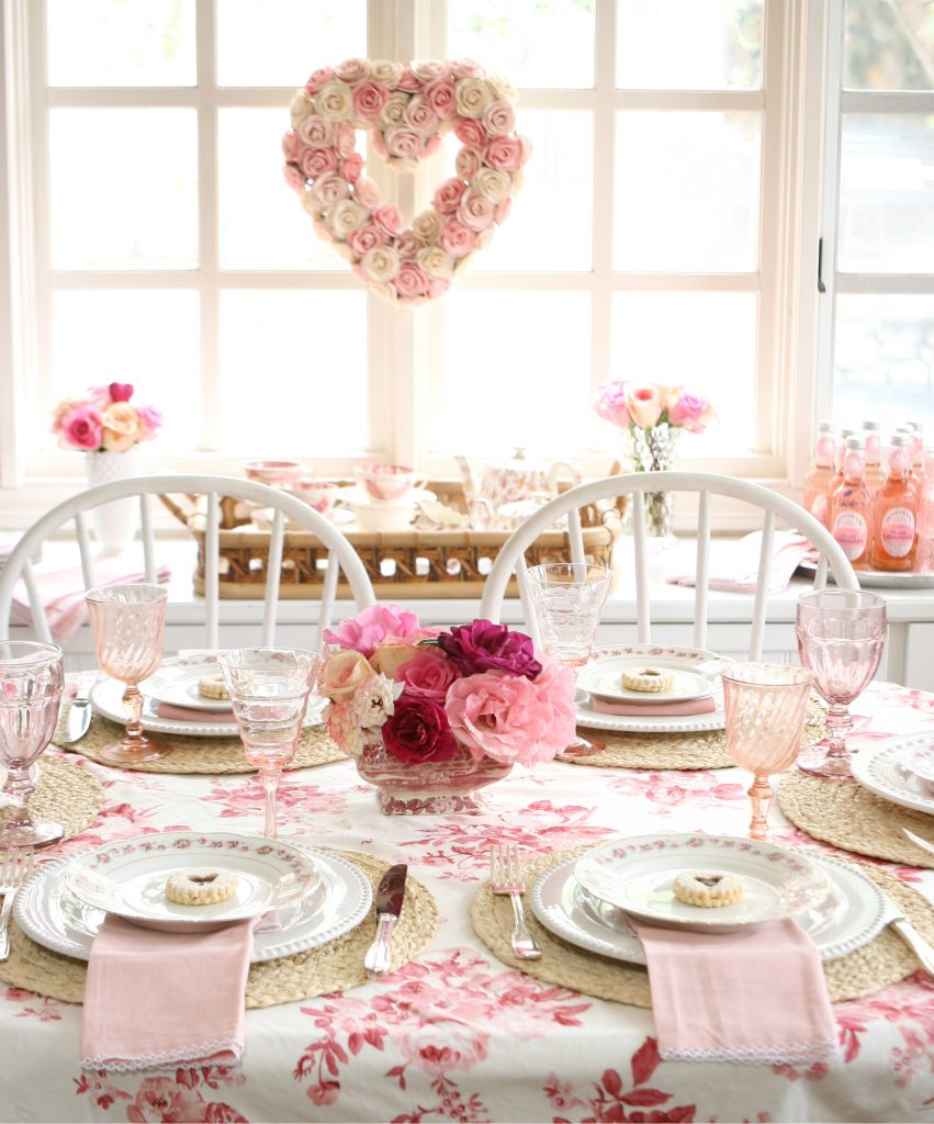garden roses in a pink glass vase for pink and red galentines tablescape