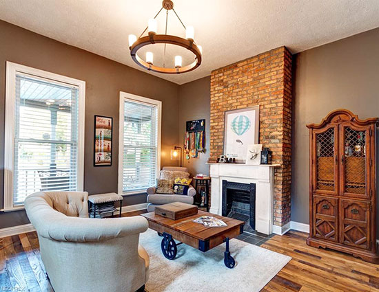 A beautiful brick fireplace and high ceilings make this a real gem.