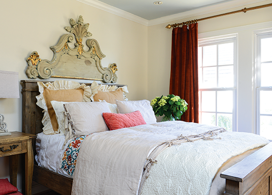 architectural salvage headboard in a tudor cottage bedroom