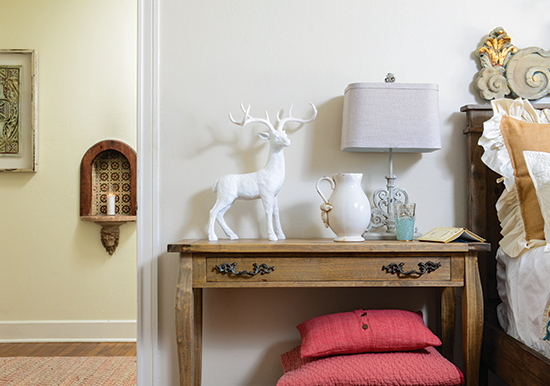 white ceramic buck on a nightstand