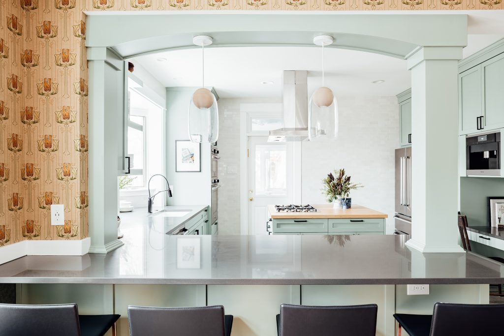 a blue archway frames a view into a remodeled kitchen.