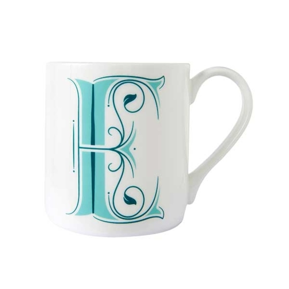 White mug with ornate, teal, monogram letter E