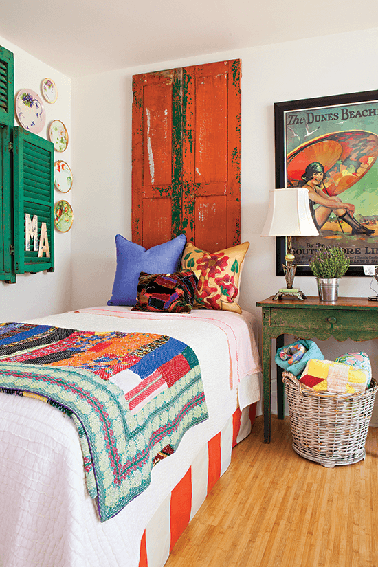 vintage bedroom with red shutter and colorful quilt