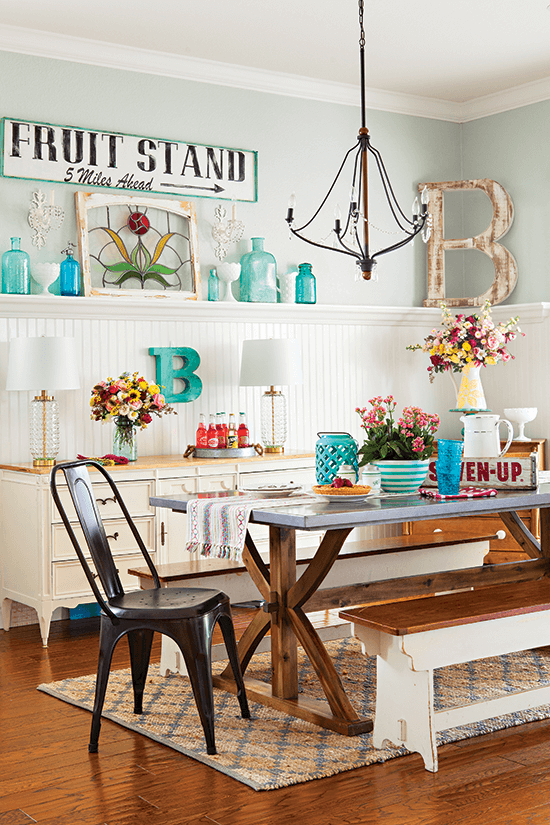 Light and bright dining room with mixed and matched treasures all around, accented with wood and teal glass.