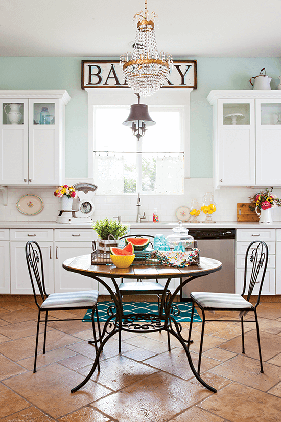 French bistro set in the kitchen, centered by the window in place of an island.