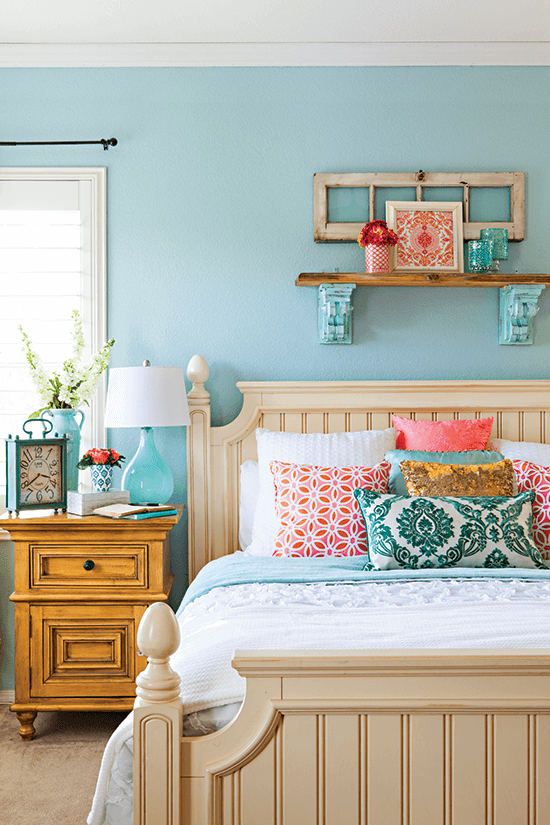 Bright and colorful bedroom with robin's egg blue walls and coral accents.
