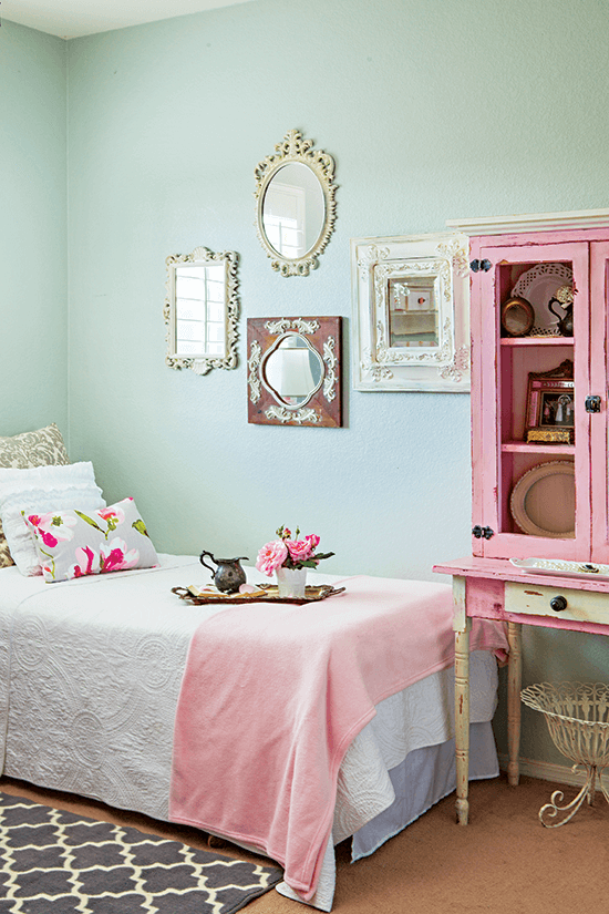 Charming light minty green walls with pink and cream accents and refurbished display cabinet.